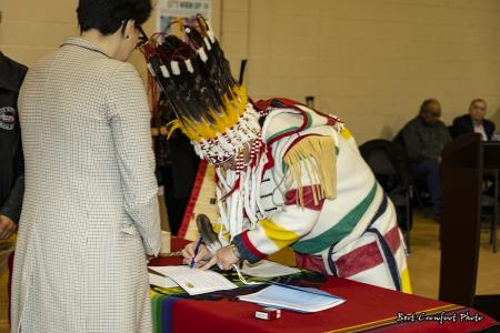 Chief Ouray Crowfoot signs official documents