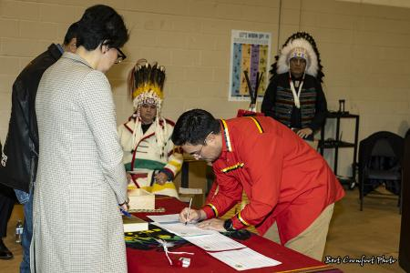 Councillor Samuel Crowfoot signs official documents