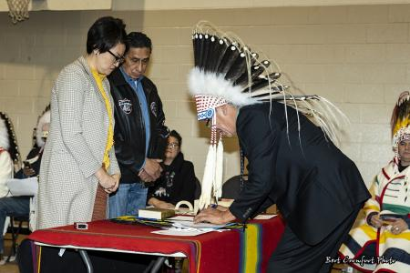 Councillor Kendall (Elroy) Panther Bone signs official documents